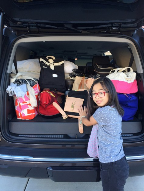 Kids and Kid Things in a GMC SUV