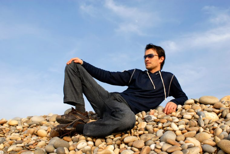 Man lounging on rocks
