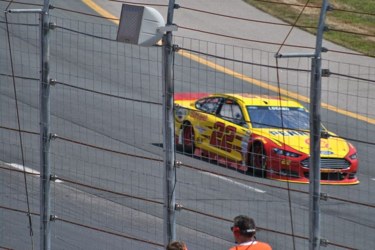 Joey Logano won Sunday's race at Kansas after spiing out Matt Kenseth who was leading with five laps to go.