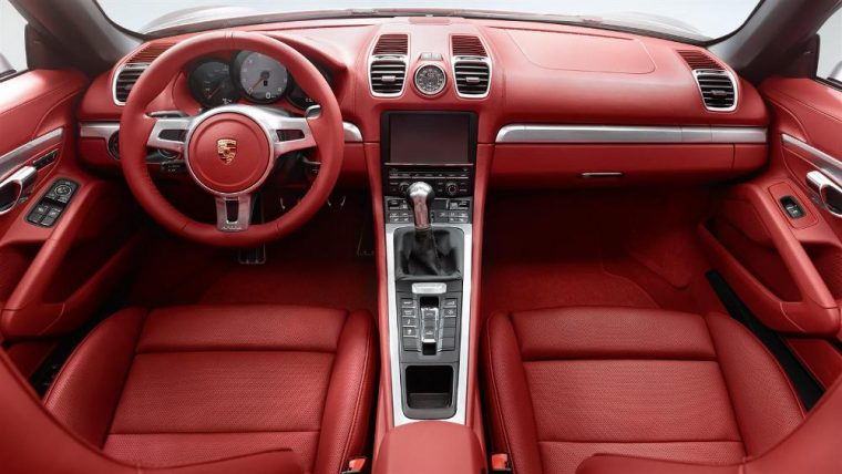 The 2016 Porsche Boxster features a 3-spoke steering wheel in leather with full-color Porsche crest