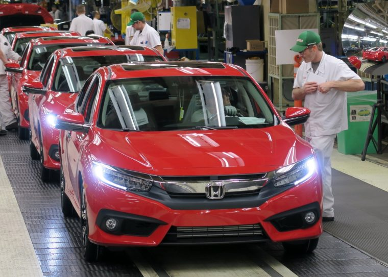 Honda of Canada Mfg. associates perform final inspections on an all-new 2016 Honda Civic Sedan as it rolls off the assembly line.