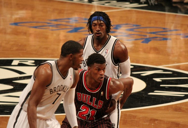 Bulls player Jimmy Butler (center) refuses to look back at Gerald Wallace