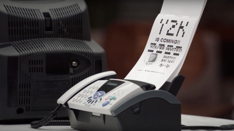 Fax machine in Chevy Volt ad mocking Toyota Prius