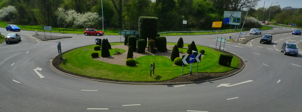 Roundabout circular traffic intersection driving island UK