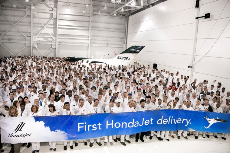 Honda Aircraft Company associates celebrate the first HondaJet delivery