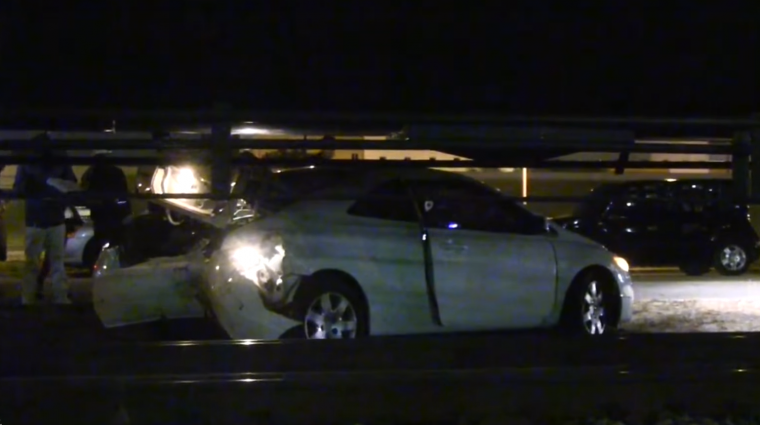 Honda Civic Coupe gets hit by train but keeps driving in video