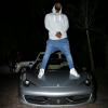 The Game stands on top of his Ferrari 458, Is his Ferrari better than Bieber's and Jennenr's?