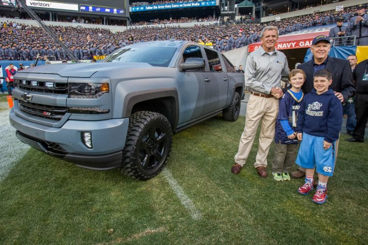 Former General Motors Chairman and CEO Dan Akerson (right), a U.S. Naval Academy graduate, presents retired U.S. Navy SEAL Master Chief and Executive Director National Navy SEAL Museum Rick Kaiser with a Chevy Silverado Special Ops Concept vehicle Saturday, December 12, 2015 at the Army-Navy football game in Philadelphia, Pennsylvania.