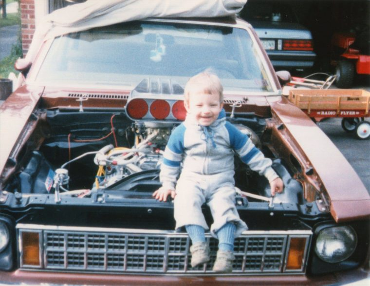 young boy family photo Chevy Nova hood