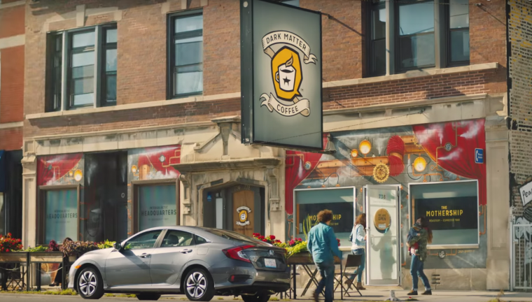 "The 2016 Honda Civic Sedan parked in front of Chicago's Dark Matter Coffee in the new ""Greatness is Within Reach"" video"