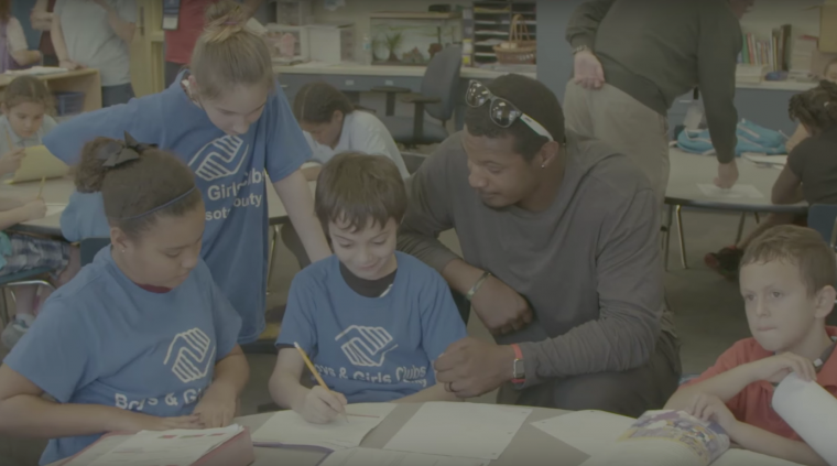 Adam Jones with boys and girls clubs of america on Chevy's #DayItForward