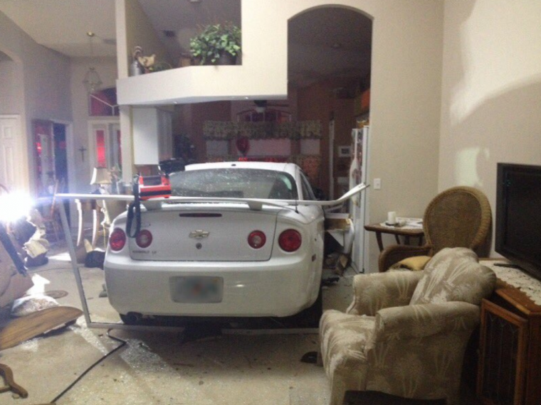 Brevard County Fire Rescue Photo of Car in Kitchen