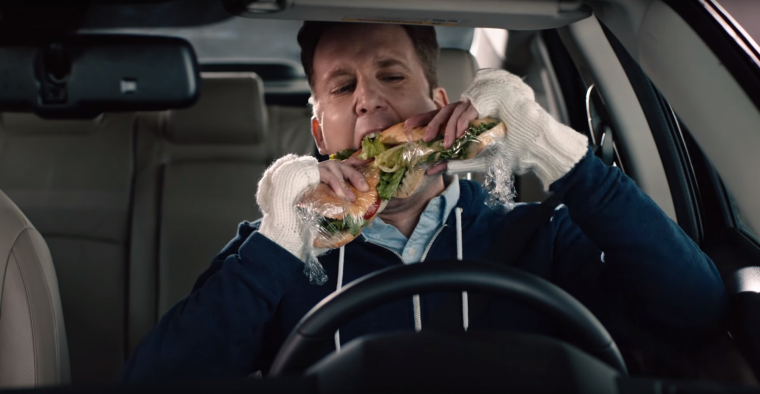 Daily Show correspondent Jordan Klepper double-fists hoagies in 2016 Honda Civic promo