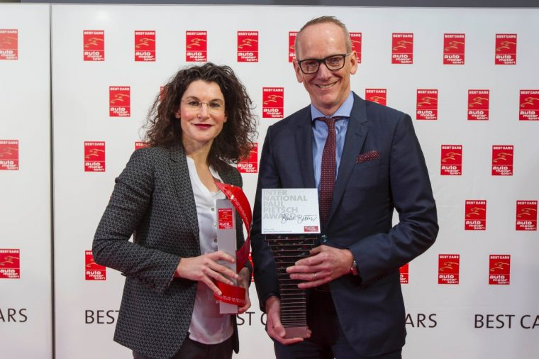 "Opel CMO Tina Müller with the ""Best Cars"" award for the ADAM and Opel Group CEO Dr. Karl-Thomas Neumann with the ""International Paul Pietsch Award"" for the IntelliLux LED ® matrix light in the new Astra"
