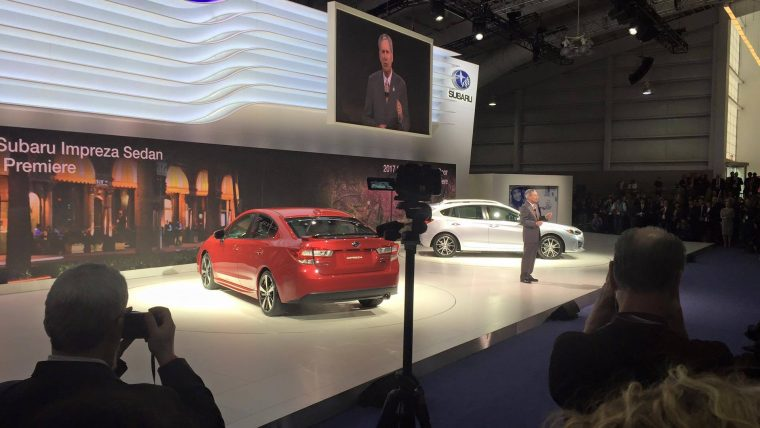 The 2017 Subaru Impreza Sedan (red) and 5-Door (white) on display at the New York International Auto Show during their debut