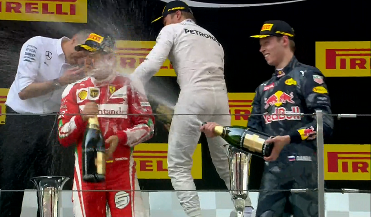 Kvyat sprays Vettel with champagne