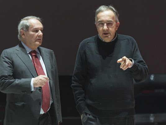 Sergio Marchionne, CEO of Fiat Chrysler, right, and Amedeo Felisa, CEO of Ferrari, left