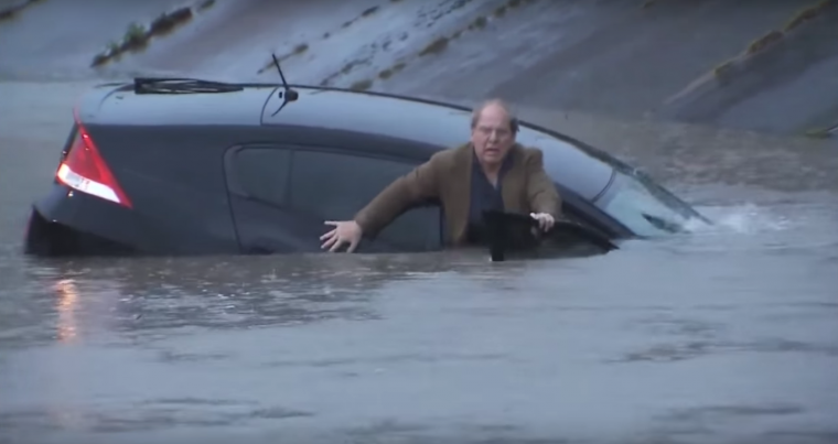 Honda Insight sinks in Houston flood water