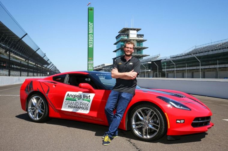 John Green poses with a 2016 Chevy Corvette Stingray Coupe pace car at Indianapolis Motor Speedway
