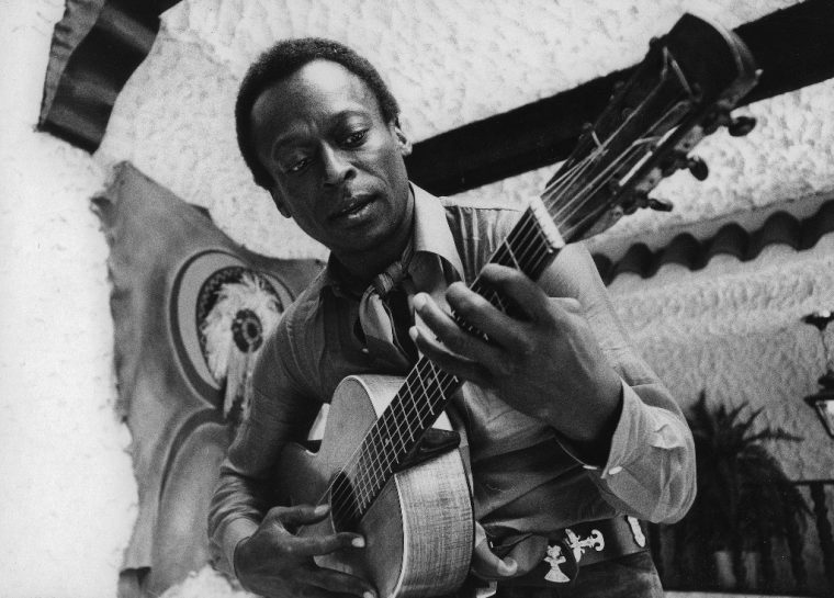 Miles Davis playing guitar
