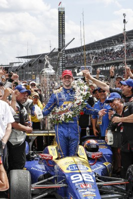 Honda's Alexander Rossi celebrates his Indy 500 win in Victory Circle.