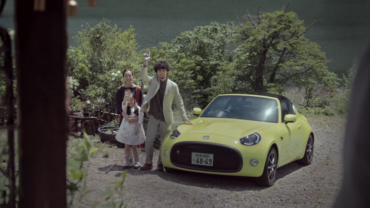 A mixed Japanese family next to a Toyota