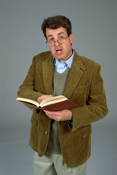 Teacher professor in brown coat glasses with book