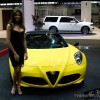 model next to Alfa Romeo 4C Spider