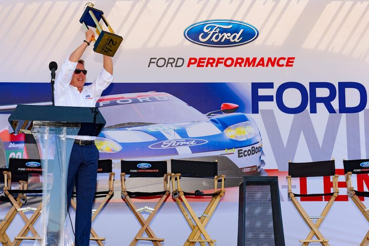 Bill Ford celebrates with Le Mans trophy