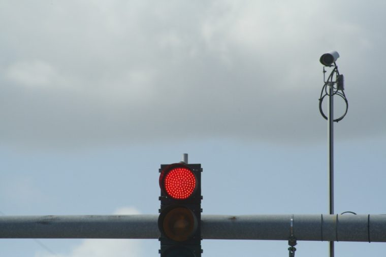 A new report from the IIHS shows that 1,296 lives have been saved because of red light cameras