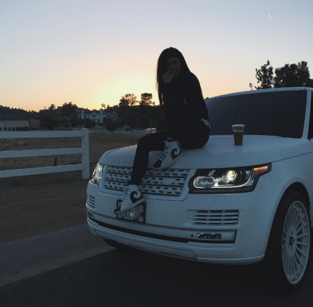 Reality TV star Kylie Jenner owns an eclectic collection of cars, which includes a Ferrari 458 Spider, Rolls Royce Wraith, and Mercedes G-Wagen