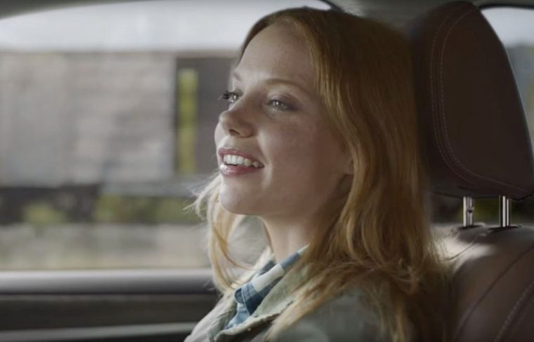 Red hair actress Megan Easton in Subaru Outback commercial boxcar train