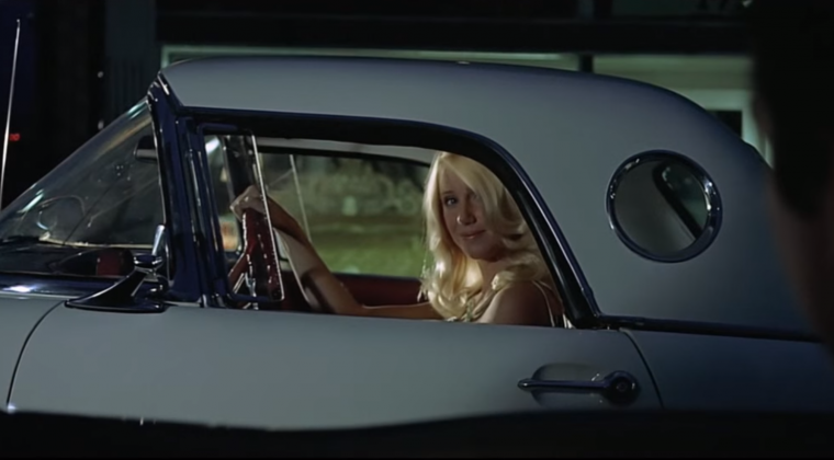 Still from the 1973 movie American Graffiti showing Suzanne Somers in a 1956 Ford Thunderbird