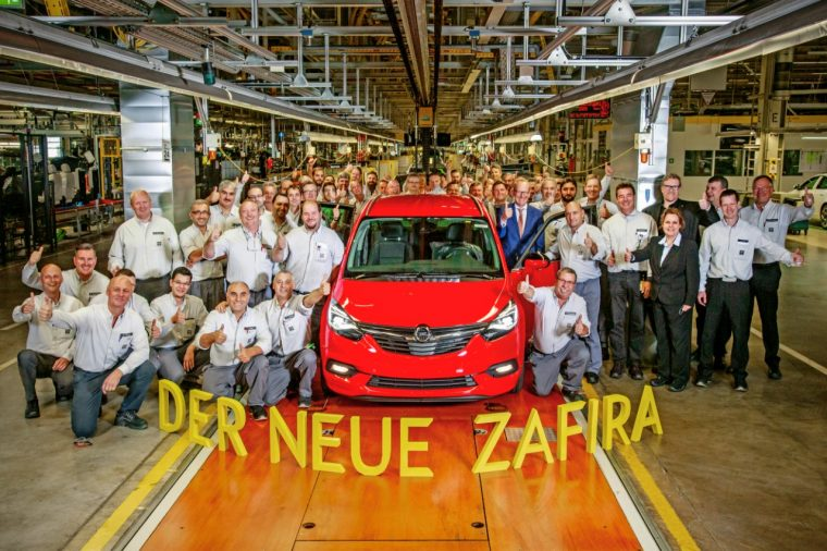 Workers pose with the new Opel Zafira at plant