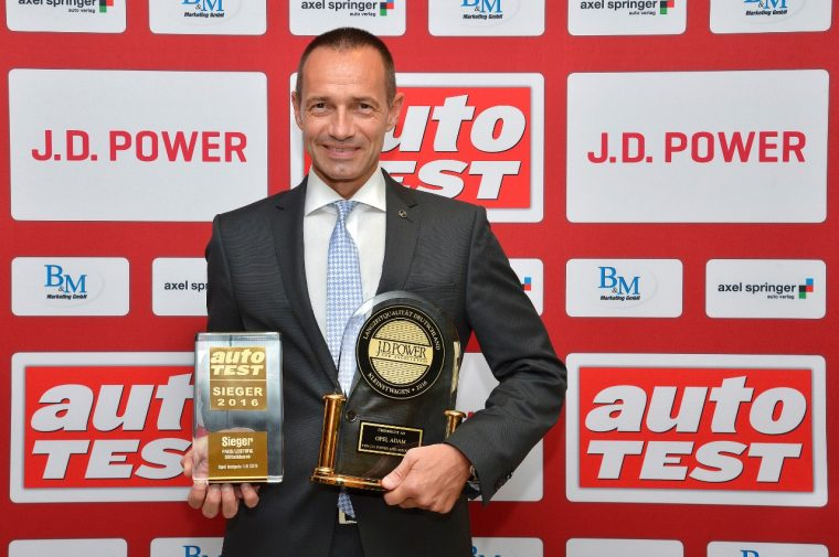 Jürgen Keller, Opel's Executive Director Sales, Marketing, and Aftersales in Germany, with awards from J.D. Power and Auto-Test