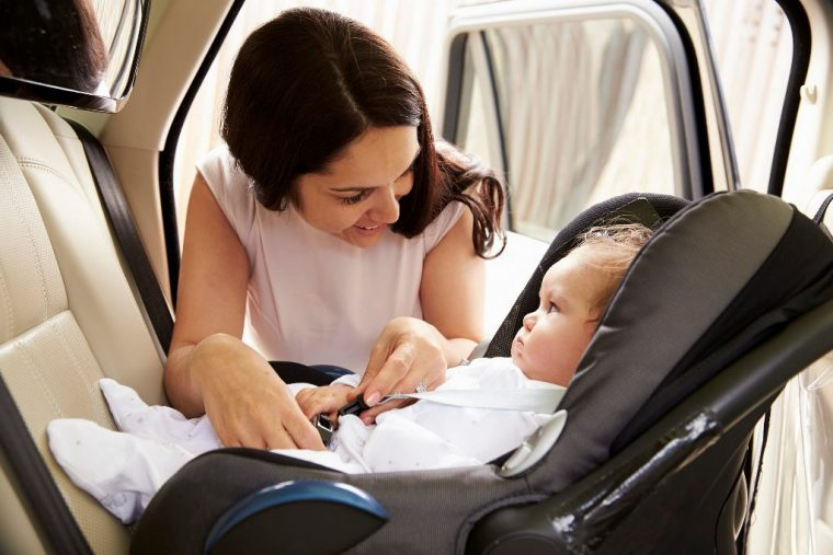 baby in car seat with mother baby names