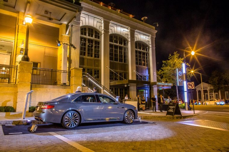 A 2017 Lincoln Continental parked outside of the Atlanta steakhouse American Cut