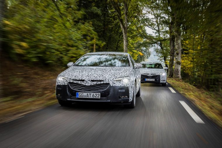 A camouflaged Opel Insignia Grand Sport is tested ahead of the 2017 Geneva Motor Show
