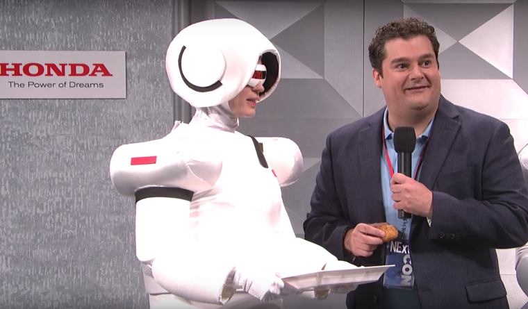 "Bobby Moynihan and host Emily Blunt in the SNL skit ""Honda Robotics"""
