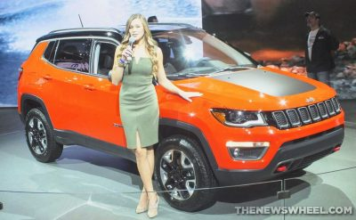 Woman model posing beside Jeep Compass at Auto Show