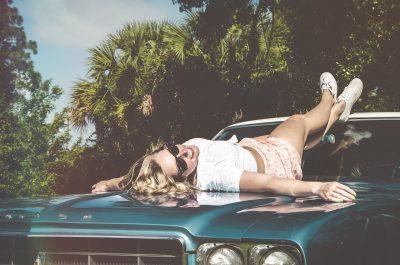 female woman model on classic car