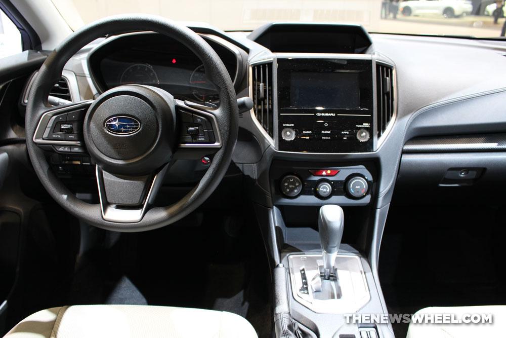 2017 Subaru Impreza 2.0i Premium blue hatchback car on display Chicago Auto Show