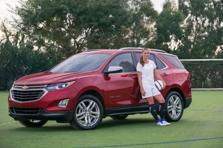 Gold Medalist Alex Morgan poses with a Chevy Equinox