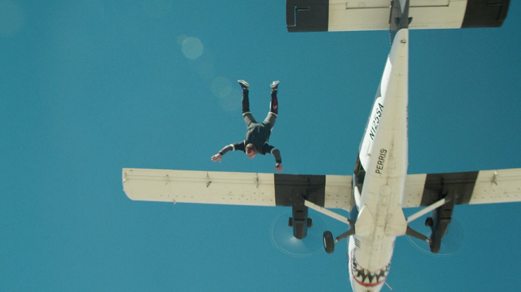 Jeremy Renner jumping out of a plane