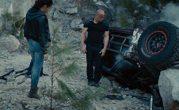 Toretto looks at his crashed car