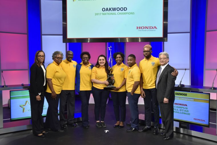 Honda representatives congratulate Oakwood University for winning the Honda Campus All-Star Challenge National Championship Tournament. Pictured from left to right: Alexandra Warnier, Manager, Corporate Social Responsibility, American Honda Motor Co., Inc.; Adrienne Matthews, Oakwood University Representative; David Knight, Vice President of Student Services, Oakwood University; Dr. Rennae Elliott, coach of Oakwood University's team; winning team members: Sesly Huerfano (team captain), Olivia Campbell, Caleb Briggs, Joshua Nwaoha; and Steve Morikawa, Vice President, Corporate Relations and Social Responsibility, American Honda Motor Co., Inc.