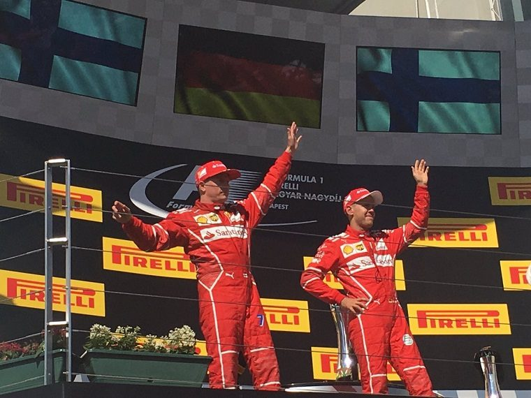 Raikkonen and Vettel wave on the podium