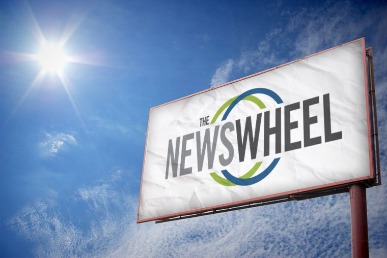 the news wheel billboard highway logo sign advertisement