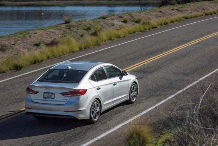 2018 Hyundai Elantra Sedan Overview car model details driving on road