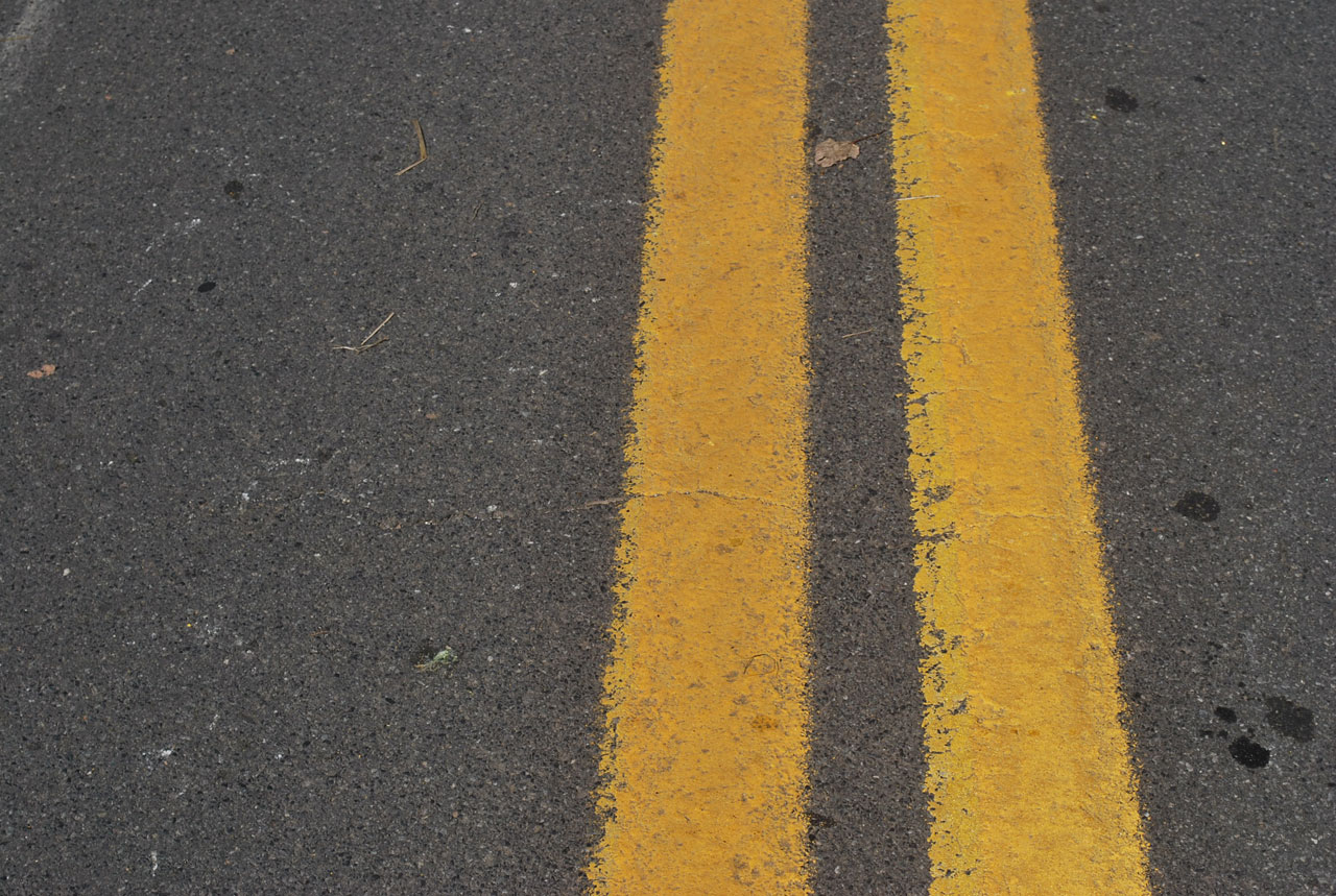 What does a solid white line on the road mean? | Yahoo Answers